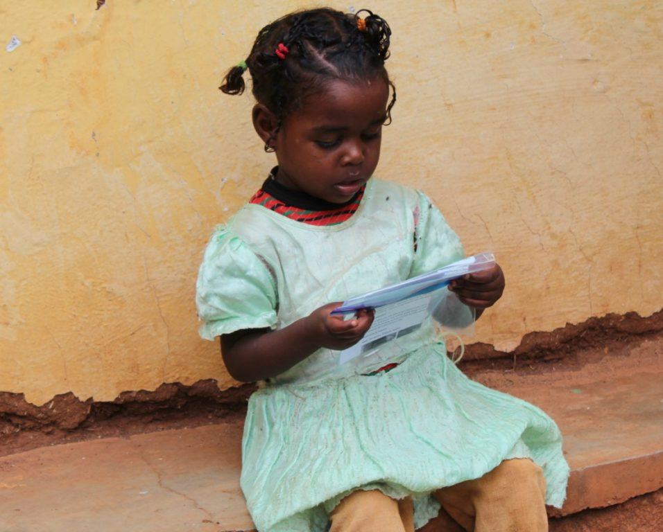 Tihun looks over a letter from her sponsor, March 2016.