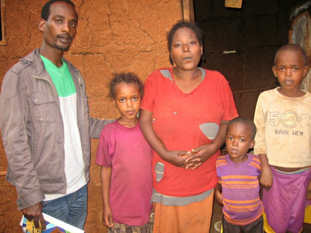 Karime with her mother and brothers, and FOVC social worker Tesfaye Kensa