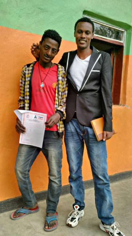 Ashebir is pictured with Mebratu Thomas, FOVC's Program Manager.