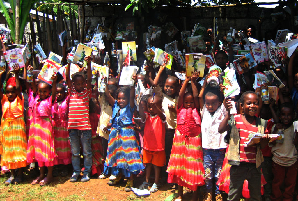 A few of the children in Dale show off their new supplies.